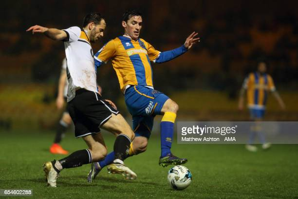 Ben Purkiss of Port Vale and Louis Dodds of Shrewsbury Town during the Sky Bet League One match between Port Vale and Shrewsbury Town at Vale Park on...