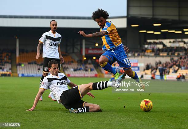 Ben Purkiss of Port Vale tackles Junior Brown of Shrewsbury Town during the Sky Bet League One match between Port Vale and Shrewsbury Town at Vale...