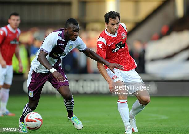Ben Purkiss of Walsall and Christian Benteke of Aston Villa