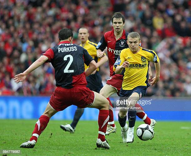 Ben Purkiss of York City and Alfie Potter of Oxford United