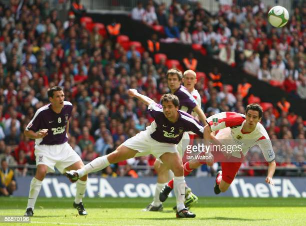 Ben Purkiss of York City tries to tackle Peter Vincent of Stevenage Borough during the FA Trophy Final between Stevenage Borough and York City at...