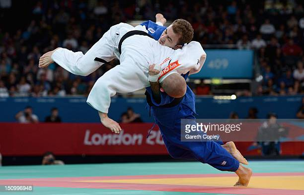 Ben Quilter of Great Britain competes against Mouloud Noura of Algeria during the Men's 60 kg Judo quarter final on day 1 of the London 2012...