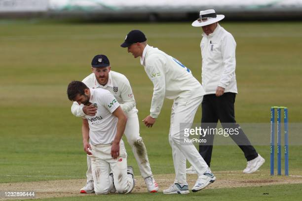 Ben Raine and Brydon Carse congratulate Mark Wood after he dismissed Ben Cox during the LV= County Championship match between Durham County Cricket...