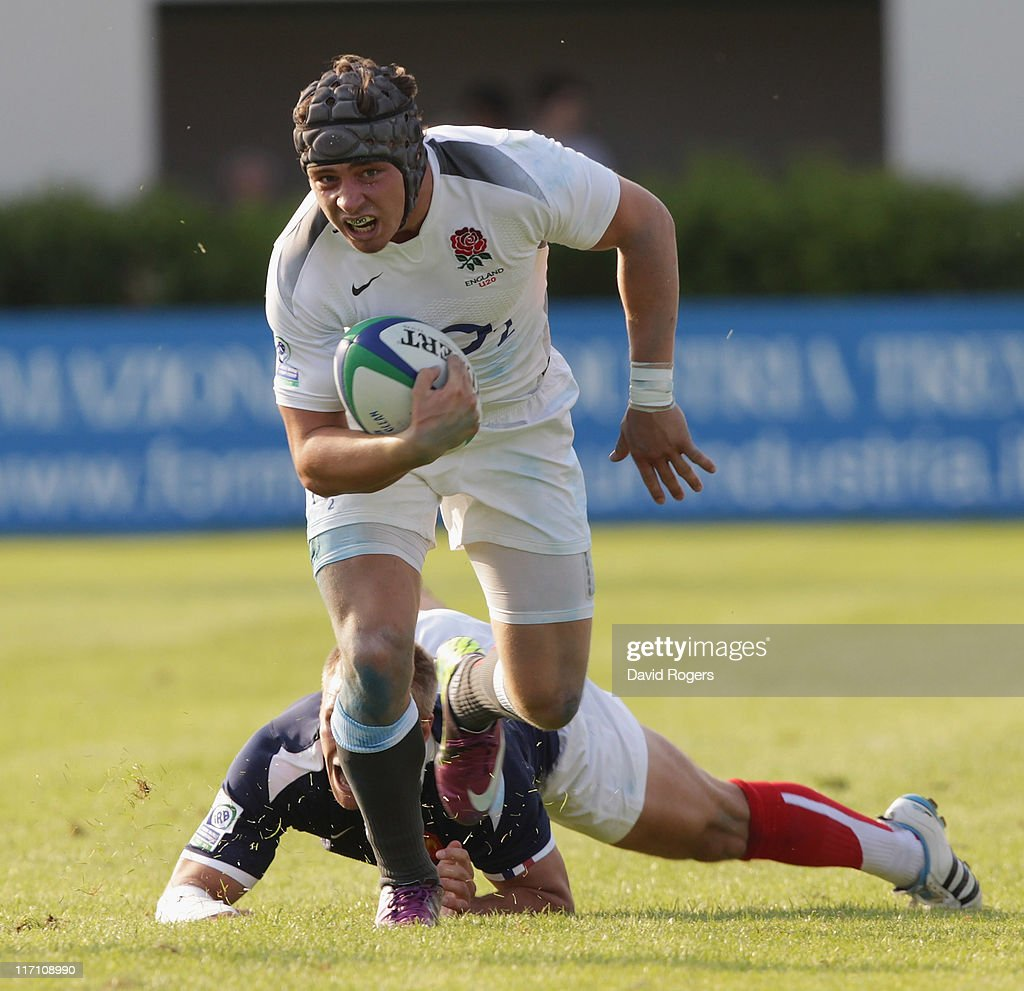 Ben Ransom of England moves away from Marvin O'Connor of France during the IRB Junior World Championship match between England and France at the Stadio Communale di Monigo on June 22, 2011 in Treviso, Italy.