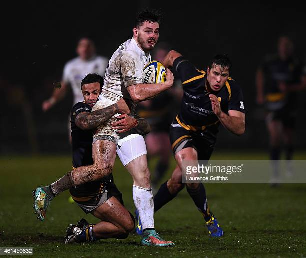 Ben Ransom of Saracens is tackled by James Stephenson of Worcester during the Aviva Premiership Rugby A League Final between Worcester Cavaliers and...