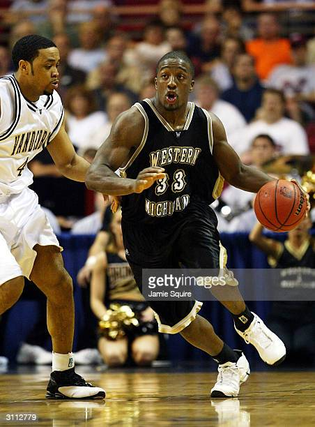 Ben Reed of the Western Michigan Broncos drives upcourts as Corey Smith of the Vanderbilt Commodores defends during the first round game of the NCAA...