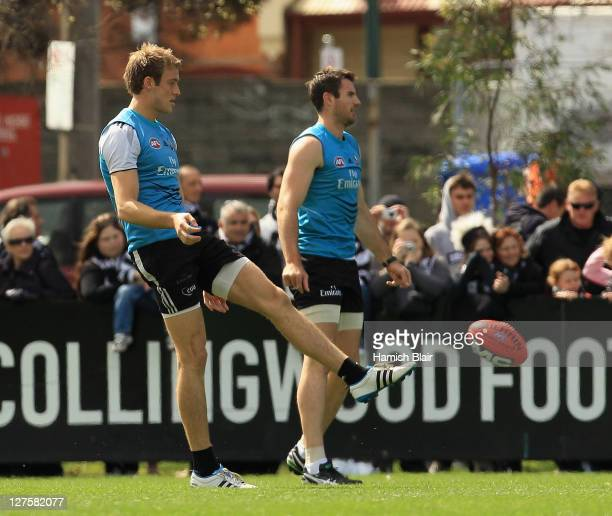 Ben Reid and Darren Jolly in action during a Collingwood Magpies AFL training session at Gosch's Paddock on September 30 2011 in Melbourne Australia