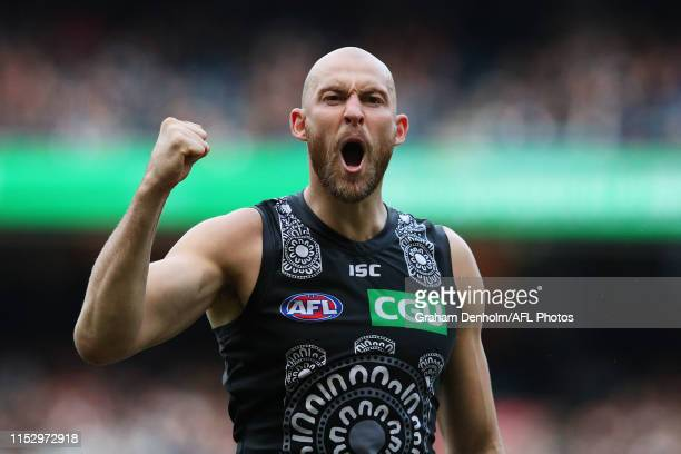 Ben Reid of the Magpies celebrates kicking a goal during the round 11 AFL match between the Collingwood Magpies and the Fremantle Dockers at...
