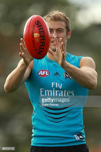 Ben Reid of the Magpies marks during a Collingwood Magpies training session at Gosch's Paddock on April 2 2010 in Melbourne Australia