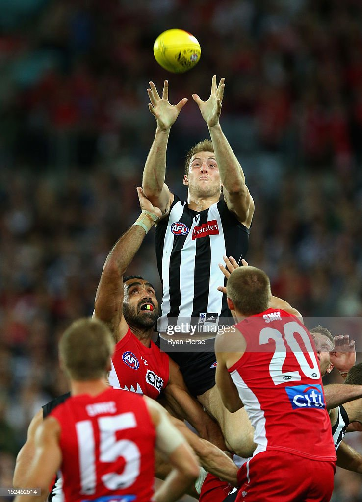 Ben Reid of the Magpies marks during the second AFL Preliminary Final match between the Sydney Swans and the Collingwood Magpies at ANZ Stadium on September 21, 2012 in Sydney, Australia.