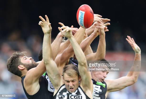 Ben Reid of the Magpies Matthew Kreuzer of the Blues and Levi Casboult of the Blues compete for the ball during the round seven AFL match between the...