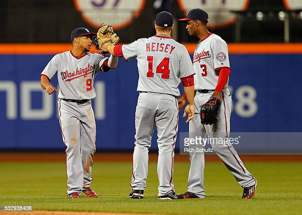 Ben Revere Chris Heisey and Michael Taylor of the Washington Nationals congratulate each other after their 91 win over the New York Mets at Citi...