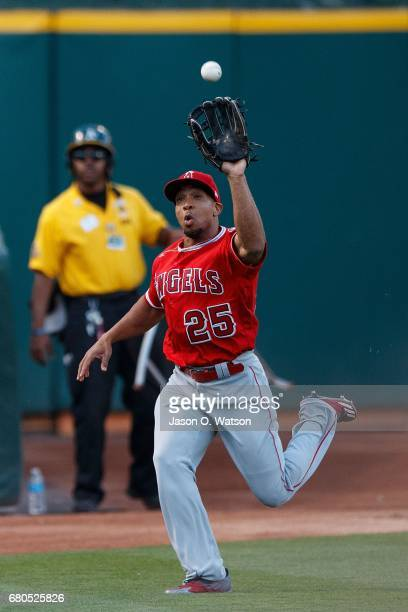 Ben Revere of the Los Angeles Angels of Anaheim catches a foul ball off the bat of Jed Lowrie of the Oakland Athletics during the first inning at the...