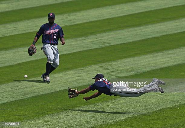 Ben Revere of the Minnesota Twins dives for a ball hit by Kevin Youkilis of the Chicago White Sox in front of teammate Denard Span at US Cellular...