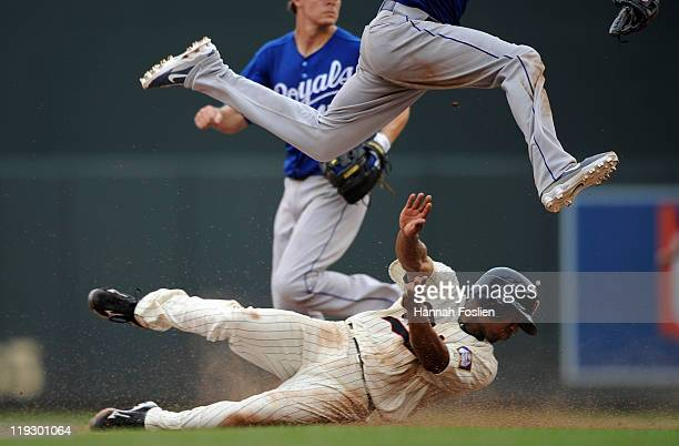 Ben Revere of the Minnesota Twins is out at second as Alcides Escobar of the Kansas City Royals leaps over him in the eighth inning on July 17 2011...