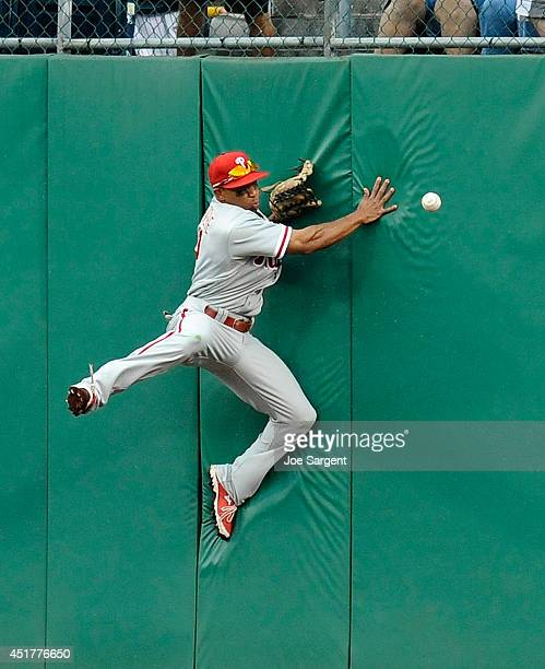 Ben Revere of the Philadelphia Phillies can't make a catch on a ball hit by Andrew McCutchen of the Pittsburgh Pirates during the eighth inning on...