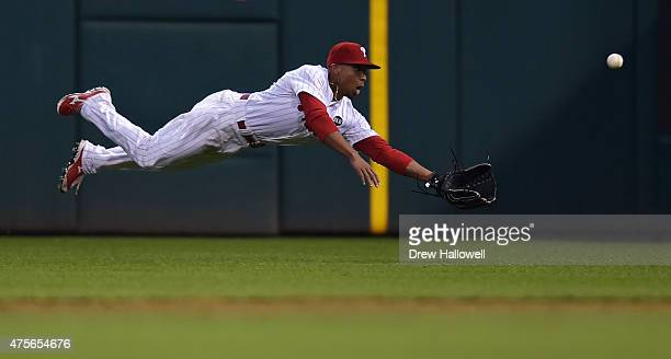 Ben Revere of the Philadelphia Phillies dives for the ball but is unable to make the catch in third inning against the Cincinnati Reds at Citizens...