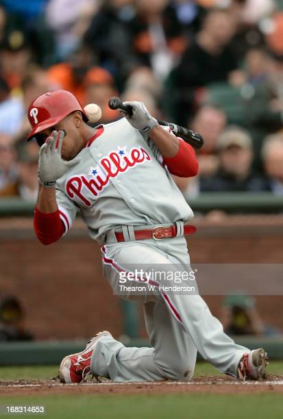 Ben Revere of the Philadelphia Phillies ducks out of the way of a close pitch thrown by Barry Zito of the San Francisco Giants in the third inning at...