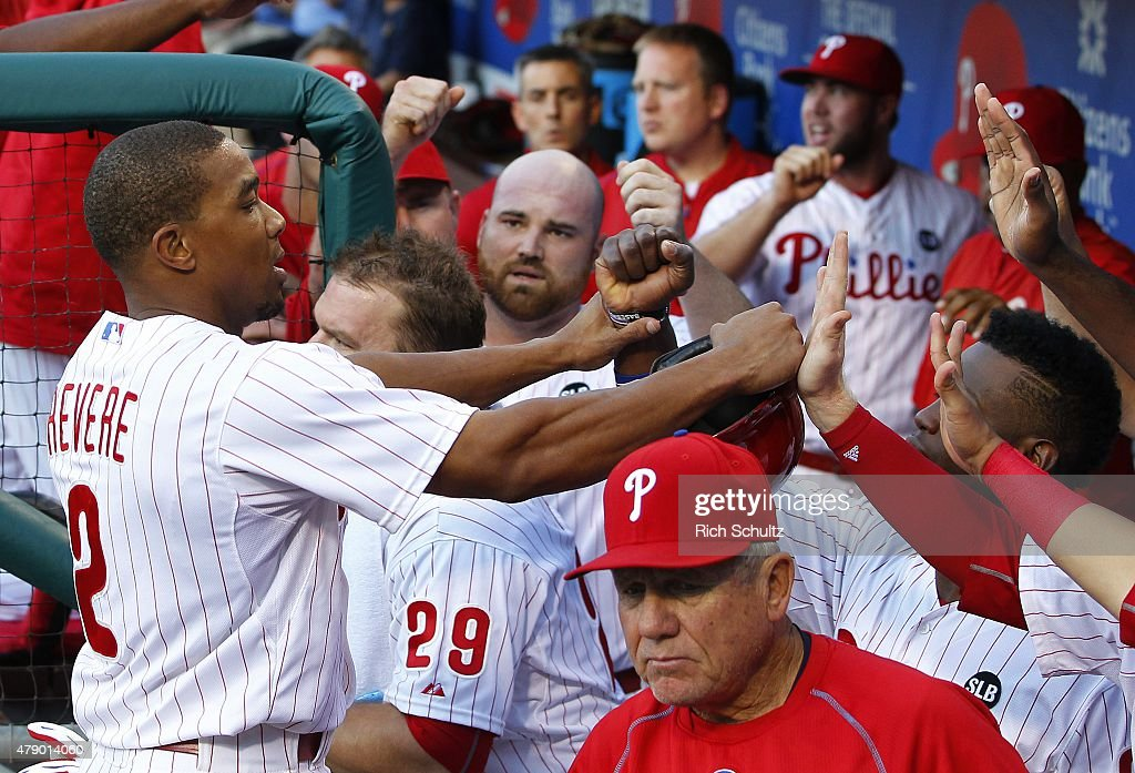 Ben Revere #2 of the Philadelphia Phillies is congratulated by teammates after scoring on an error on a ball hit by Cesar Hernandez #16 against the Milwaukee Brewers during the first inning of a MLB game at Citizens Bank Park on June 29, 2015 in Philadelphia, Pennsylvania.