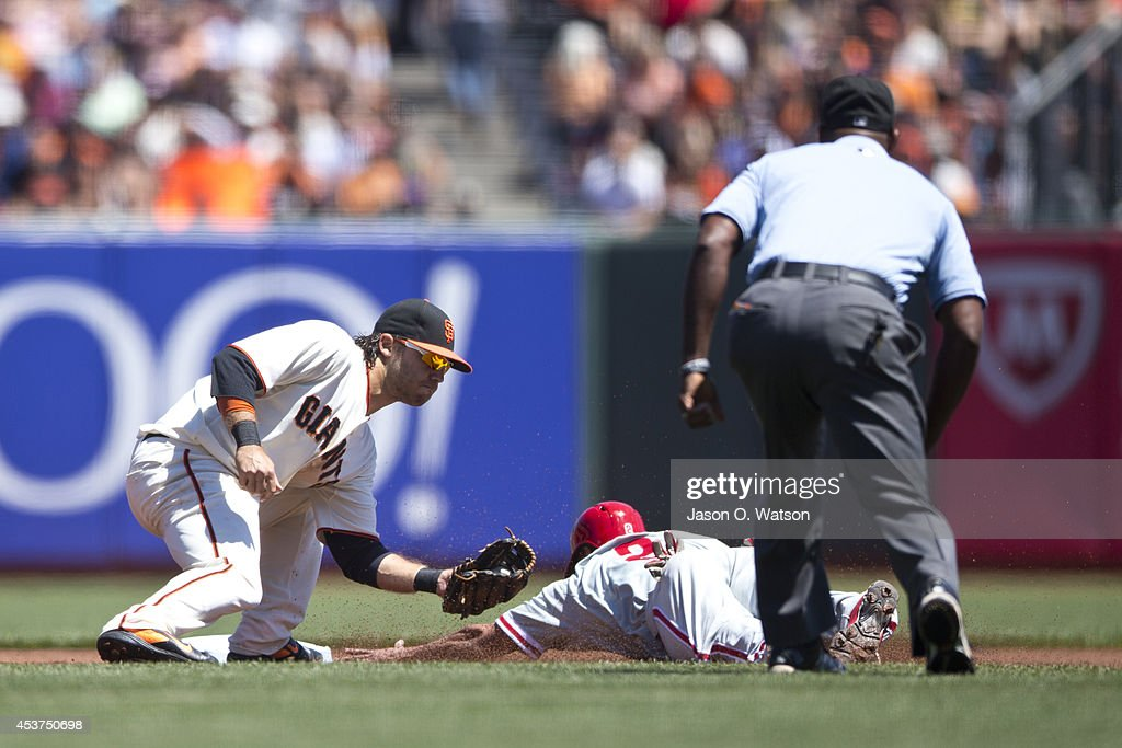 Ben Revere #2 of the Philadelphia Phillies is tagged out attempting to steal second base by Brandon Crawford #35 of the San Francisco Giants in front of umpire Alan Porter #64 during the first inning at AT&T Park on August 17, 2014 in San Francisco, California.