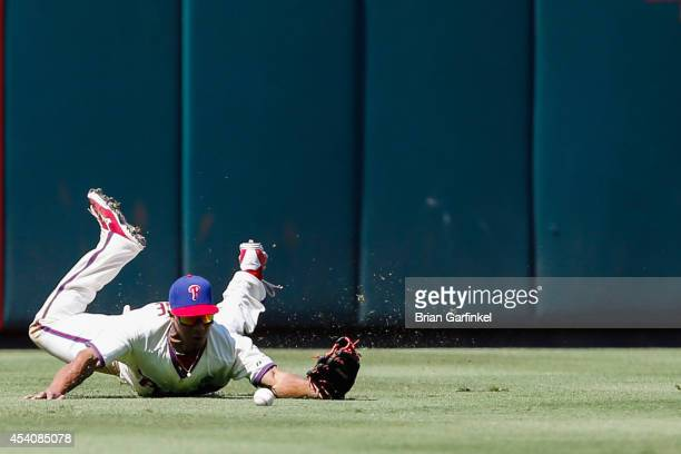 Ben Revere of the Philadelphia Phillies is unable to catch a long fly ball hit by Jhonny Peralta of the St Louis Cardinals Peralta doubled in the...