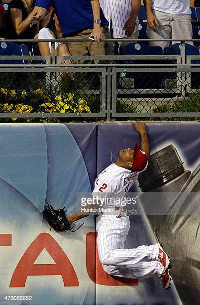 Ben Revere of the Philadelphia Phillies jumps and attempts to catch a home run in the fourth inning during a game against the Pittsburgh Pirates at...