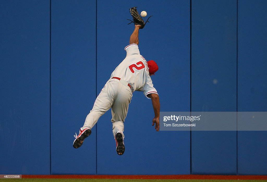 Ben Revere #2 of the Philadelphia Phillies jumps but cannot catch a double hit by Russell Martin #55 of the Toronto Blue Jays in the fourth inning during MLB game action on July 28, 2015 at Rogers Centre in Toronto, Ontario, Canada.