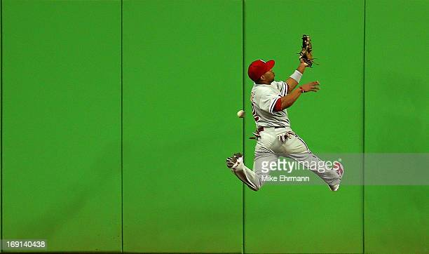 Ben Revere of the Philadelphia Phillies misses a fly ball during a game against the Miami Marlins at Marlins Park on May 20 2013 in Miami Florida