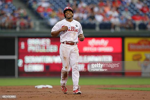 Ben Revere of the Philadelphia Phillies smiles on the base path after a foul ball in the first inning during a game against the Atlanta Braves at...