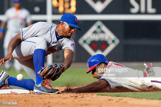 Ben Revere of the Philadelphia Phillies steals second base as Jordany Valdespin of the New York Mets drops the ball during a game at Citizens Bank...