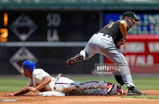Ben Revere of the Philadelphia Phillies steals second base as the ball gets past second baseman Derek Dietrich of the Miami Marlins during the second...