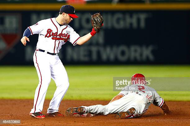Ben Revere of the Philadelphia Phillies steals second base under Tommy La Stella of the Atlanta Braves in the sixth inning at Turner Field on...