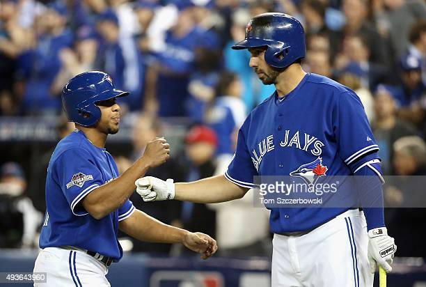 Ben Revere of the Toronto Blue Jays celebrates his run off of a bases loaded walk with Chris Colabello to take a 20 lead over the Kansas City Royals...