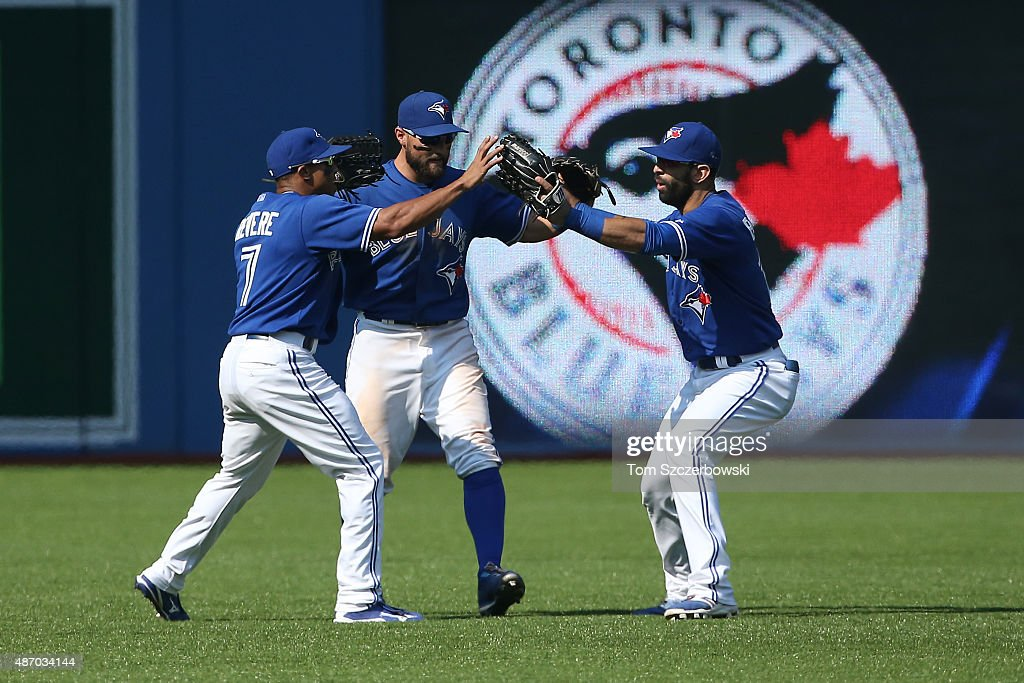 Ben Revere #7 of the Toronto Blue Jays celebrates their victory with Kevin Pillar #11 and Jose Bautista #19 during MLB game action against the Baltimore Orioles on September 5, 2015 at Rogers Centre in Toronto, Ontario, Canada.