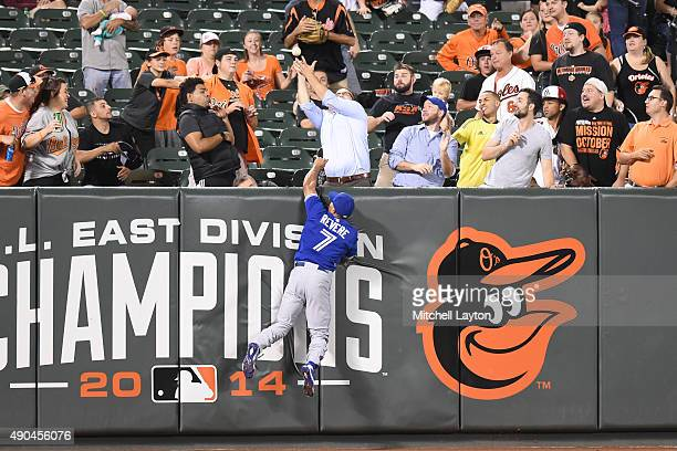 Ben Revere of the Toronto Blue Jays is not able to reach a ball off the bat of Ryan Flaherty of the Baltimore Orioles that went for a threerun home...