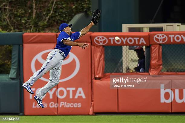 Ben Revere of the Toronto Blue Jays is unable to make a catch in the sixth inning against the Philadelphia Phillies at Citizens Bank Park on August...