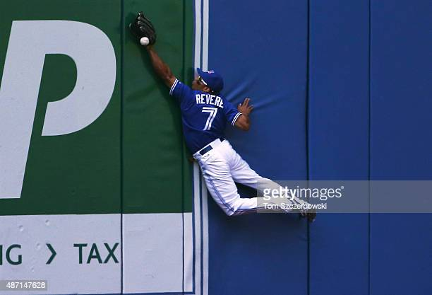 Ben Revere of the Toronto Blue Jays leaps but cannot catch an RBI double by Jimmy Paredes of the Baltimore Orioles in the sixth inning during MLB...
