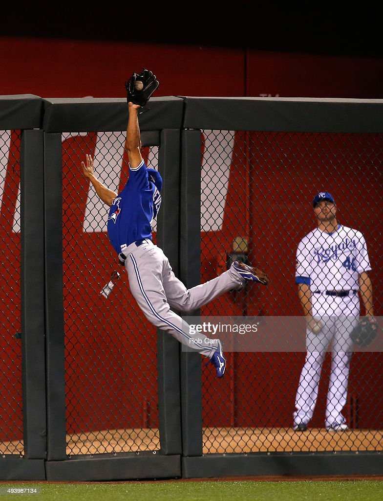 Ben Revere #7 of the Toronto Blue Jays makes a leaping catch at the wall on a ball hit by Salvador Perez #13 of the Kansas City Royals in the seventh inning in game six of the 2015 MLB American League Championship Series at Kauffman Stadium on October 23, 2015 in Kansas City, Missouri.