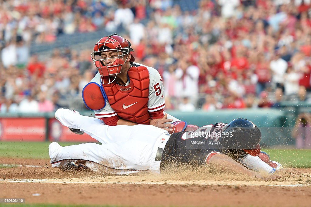 Ben Revere #9 of the Washington Nationals beats the tag by Carlos Ruiz #51 of the Philadelphia Phillies on a Jayson Werth #28 triple in the third inning during a baseball game at Nationals Park on June 10, 2016 in Washington, DC.