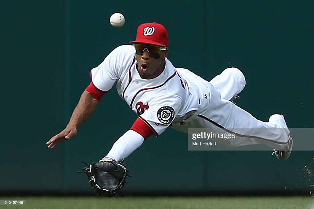 Ben Revere #9 of the Washington Nationals misses the catch in the first inning against the Chicago Cubs at Nationals Park on June 15, 2016 in Washington, DC.