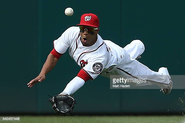 Ben Revere of the Washington Nationals misses the catch in the first inning against the Chicago Cubs at Nationals Park on June 15 2016 in Washington...