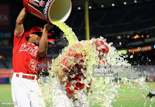 Ben Revere pours a sports drink on Cliff Pennington of the Los Angeles Angels after defeating the Oakland Athletics 108 in a game at Angel Stadium of...