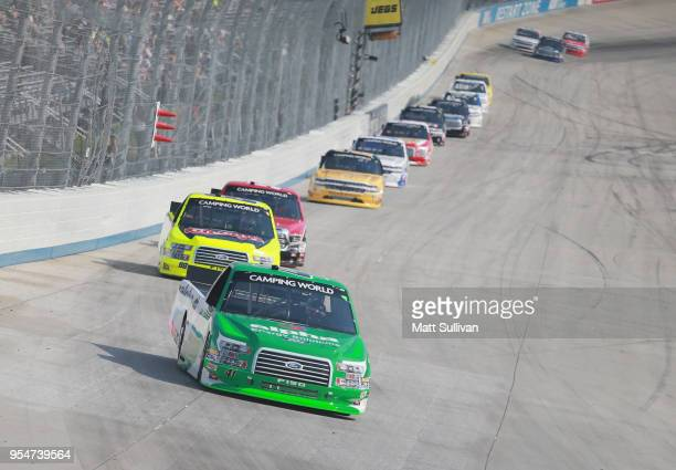 Ben Rhodes driver of the Alpha Energy Solutions Ford leads a pack of cars during the NASCAR Camping World Truck Series JEGS 200 at Dover...