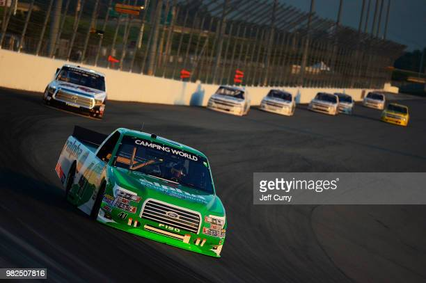 Ben Rhodes driver of the Alpha Energy Solutions Ford leads a pack of trucks during the NASCAR Camping World Truck Series Villa Lighting delivers the...
