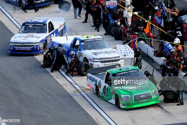 Ben Rhodes driver of the Alpha Energy Solutions Ford pits during the NASCAR Camping World Truck Series JEGS 200 at Dover International Speedway on...