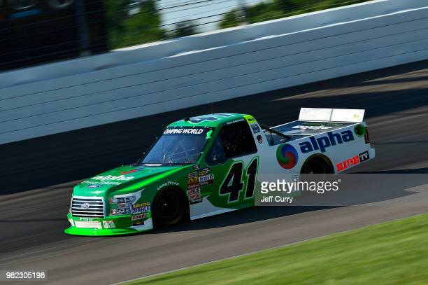 Ben Rhodes driver of the Alpha Energy Solutions Fordduring qualifying for the NASCAR Camping World Truck Series Villa Lighting delivers the Eaton 200...