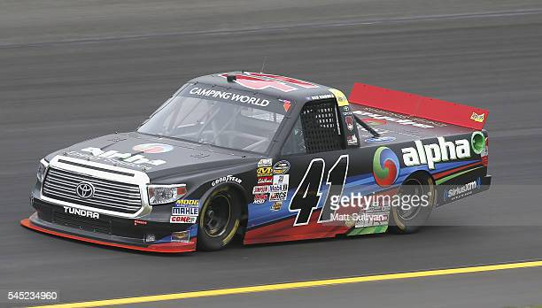 Ben Rhodes driver of the Alpha Energy Solutions Toyota practices for the NASCAR Camping World Truck Series Buckle Up In Your Truck 225 at Kentucky...