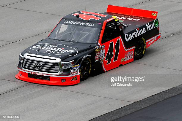 Ben Rhodes driver of the Carolina Nut Co Toyota practices for the NASCAR Camping World Truck Series at Dover International Speedway on May 12 2016 in...