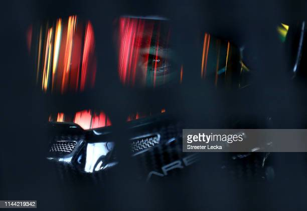 Ben Rhodes driver of the Carolina Nut Ford sits in his truck during practice for the NASCAR Gander Outdoors Truck Series North Carolina Education...
