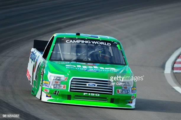 Ben Rhodes driver of the Racing Ford drives during practice for the NASCAR Camping World Truck Series Villa Lighting delivers the Eaton 200 at...